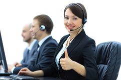Manager of the call centre shows thumb up sitting at your Desk. In the workplace Royalty Free Stock Photography