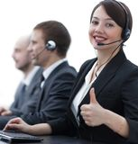 Manager of the call centre shows thumb up sitting at your Desk. In the workplace Royalty Free Stock Image