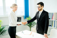 Manager and candidate shaking hands. HR manager is shaking hands with a candidate after an interview royalty free stock image
