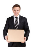 Manager with cardboard box. Manager in suit holding cardboard box, isolated on white Royalty Free Stock Photography