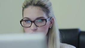 Manager carefully examining document on laptop