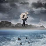 Manager carry a money sack above the sea Stock Photos