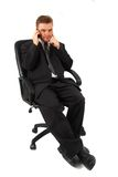 Manager in chair and pohone Stock Images