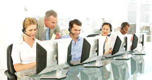 Manager checking on call centre agents Stock Photos
