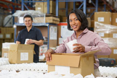 Manager Checking Goods On Production Line. Smiling Royalty Free Stock Images