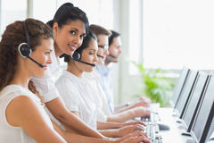 Manager checking her staffs work in call center Royalty Free Stock Images