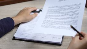 Manager checking Schengen zone visa application, signing deportation documents. Stock footage stock footage