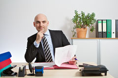 Manager checks an offer Stock Photo