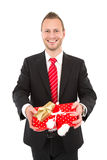 Manager with Christmas gift - man isolated on white background Royalty Free Stock Images