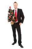 Manager with christmas tree - man isolated on white background Royalty Free Stock Photography