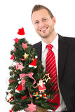 Manager with christmas tree Royalty Free Stock Photos