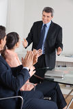 Manager clapping hands for Royalty Free Stock Photography