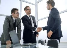 Manager and client shaking hands in Bank office. Concept of partnership royalty free stock photos
