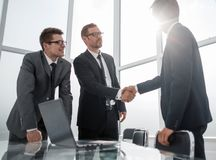 Manager and client shaking hands in Bank office. Concept of partnership stock images