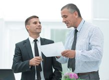 Manager and client to discuss the terms of the contract Royalty Free Stock Photography