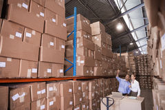 Manager and colleague at warehouse Royalty Free Stock Photography