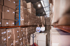 Manager and colleague at warehouse Royalty Free Stock Images