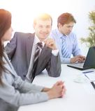 Manager and colleagues in the workplace Royalty Free Stock Photography