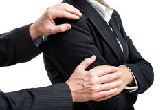 Manager comfort his friend. Holding his hands stock photo