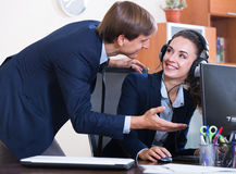 Manager consulting call center operator in office Stock Photo