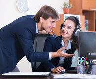 Manager consulting call center operator in office Stock Image