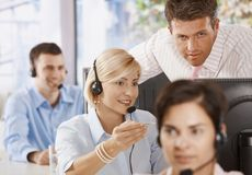 Customer service representatives. Manager controlling customer service operators in office royalty free stock photography