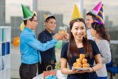 Manager with cupcakes Royalty Free Stock Photos