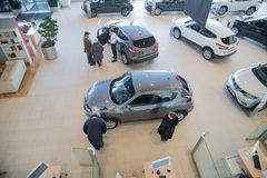 Manager, customer and cars in showroom of dealership Nissan in Nizhny Novgorodcity in 2018 royalty free stock photos
