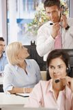 Manager at customer service. Manager checking customer service operators in office Stock Image