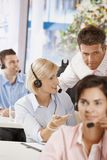 Manager at customer service. Manager checking customer service operators in office Royalty Free Stock Image
