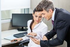 Manager And Customer Service Agent Using Tablet Stock Photo