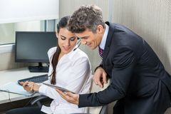Manager And Customer Service Executive Using Stock Image