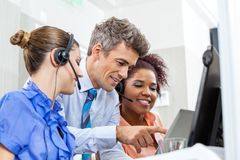 Manager With Customer Service Executives Using Royalty Free Stock Photo