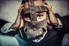 Manager, dangerous business man with iron mask and expressions Stock Photography