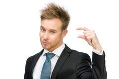 Manager, der kleine Menge von etwas zeigt Stockbild
