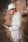 Manager with diary in warehouse Royalty Free Stock Photo