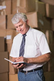 Manager with diary in warehouse Stock Images