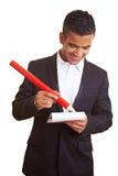 Manager die met rood potlood schrijft royalty-vrije stock fotografie