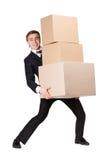 Manager die stapel van kartondozen overhandigt Stock Foto's