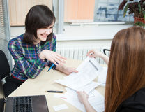 Manager discussing with client. In the office Royalty Free Stock Image