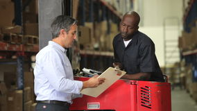Manager Discussing Paperwork With Fork Lift Driver stock footage