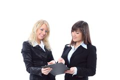 Manager discussing work with her colleague. Royalty Free Stock Photo