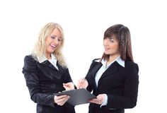 Manager discussing work with her colleague. Stock Photo