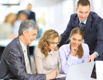 manager discussing work with his colleagues Stock Images