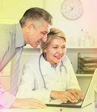Manager and doctor reading news Stock Images