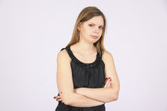 Manager in dress looking with distrust Royalty Free Stock Images
