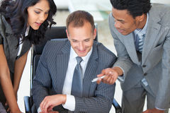 Manager with employees working in office Royalty Free Stock Image