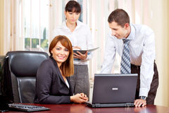 Manager and employers. Handsome female manager with employers in office Royalty Free Stock Photo