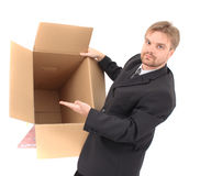 Manager and empty box. Man and empty box isolated on the white background Royalty Free Stock Photos