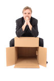 Manager and empty box. Man and empty box isolated on the white background Stock Photo